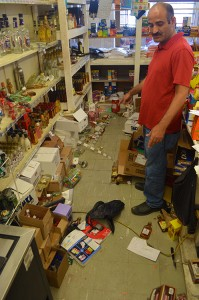 DAILY NEWS PHOTO/Jesse Wright Thrifty Shop owner Sam Kaid shows the sight of an altercation between Ronald Warren and store employee Hal Moon, who fended off Warren's attack during an attempted robbery Tuesday evening.